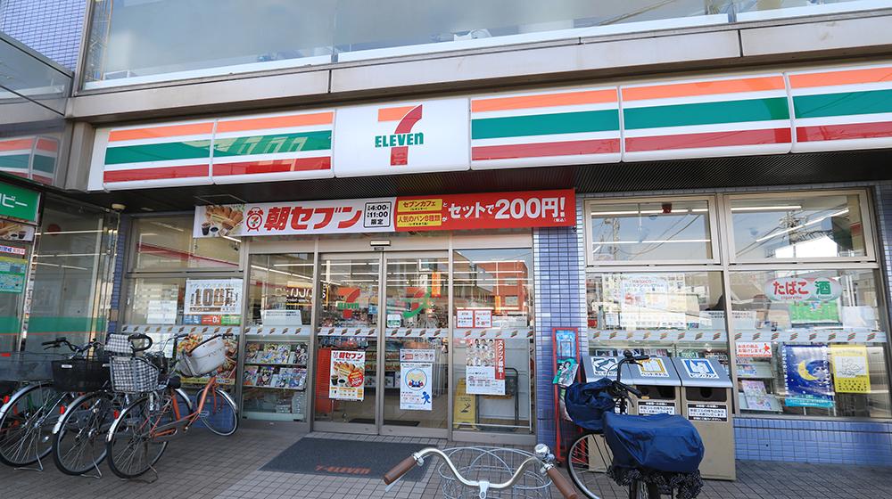 セブンイレブン 大袋駅前店 約30m(徒歩1分)