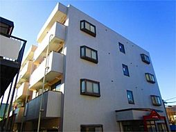 東京都多摩市馬引沢1丁目の賃貸マンションの外観