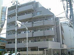 TOMIKURAXI[4階]の外観