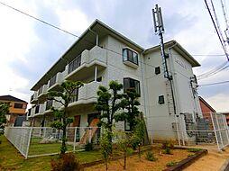 大阪府富田林市津々山台2丁目の賃貸マンションの外観