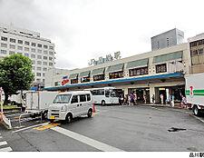 品川駅(現地まで1120m)