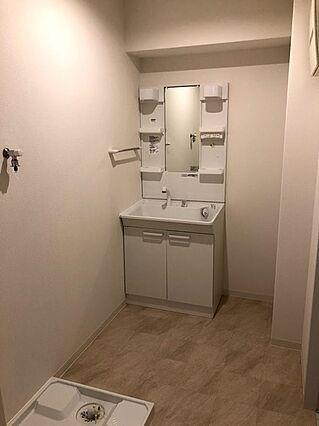 洗濯機を置いて...