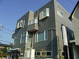 東京都多摩市唐木田1丁目の賃貸マンションの外観