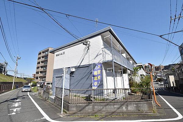 東京都多摩市中沢2丁目の賃貸アパートの外観