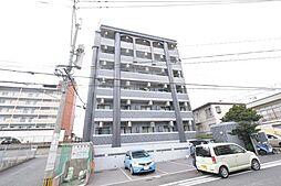 KMマンション産医大前[302号室]の外観