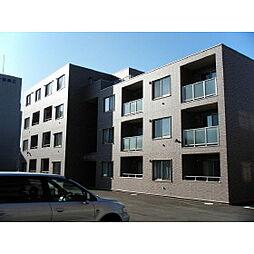 Y'sカーネリアン富岡[3階]の外観