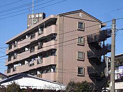 ニュー松戸コーポE棟[4階]の外観
