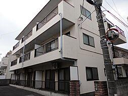 マンション新明[102号室]の外観