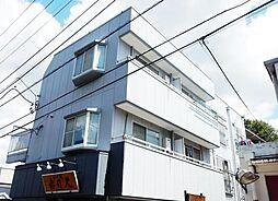 東京都多摩市貝取1丁目の賃貸マンションの外観